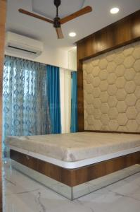 Gallery Cover Image of 820 Sq.ft 2 BHK Apartment for buy in Om Paraiso, Padle Gaon for 6250000