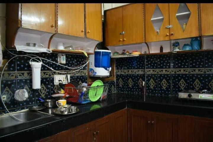लाजपत नगर में ओम साई पीजी में किचन की तस्वीर