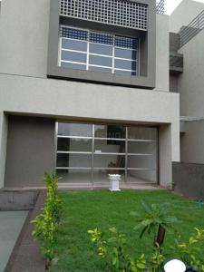 Gallery Cover Image of 3600 Sq.ft 4 BHK Independent House for rent in Shela for 75000