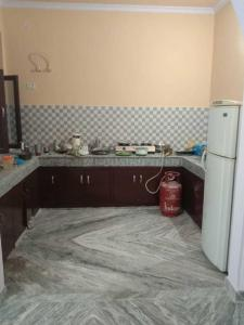 Kitchen Image of Om Sai PG in Palam Vihar Extension