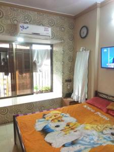 Gallery Cover Image of 980 Sq.ft 2 BHK Apartment for rent in Malad West for 35000