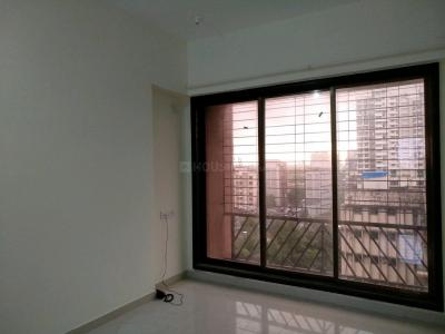 Gallery Cover Image of 870 Sq.ft 2 BHK Apartment for buy in Malad West for 11800000
