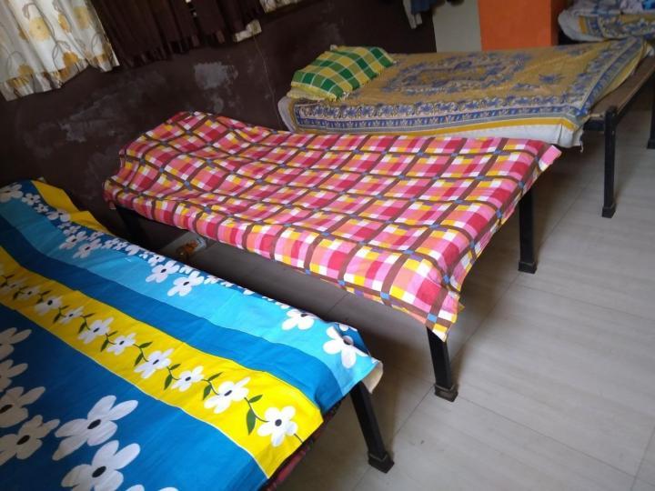 ऐरोली में हिंगलजमाता पीजी के बेडरूम की तस्वीर