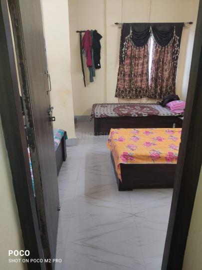 कॉलेज स्ट्रीट में होम के बेडरूम की तस्वीर