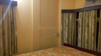 मजूमदार पेइंग गेस्ट हाउस इन न्यू अलिपोरे के बेडरूम की तस्वीर