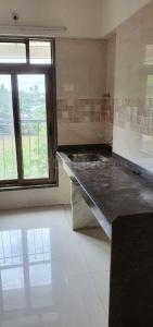 Gallery Cover Image of 750 Sq.ft 1 BHK Apartment for buy in Abhigna Avirahi Heights, Malad West for 8500000