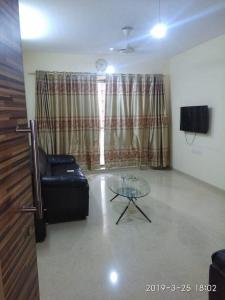 Gallery Cover Image of 876 Sq.ft 2 BHK Apartment for rent in Kalpataru Aura, Ghatkopar West for 62000