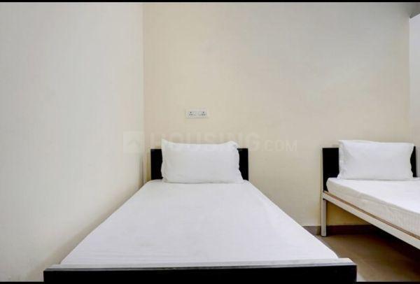 खराड़ी में सियास पीजी अकॉमोडेशन के बेडरूम की तस्वीर