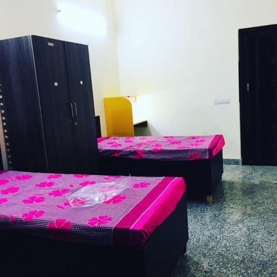 Bedroom Image of Savitri Girls PG in Uttam Nagar