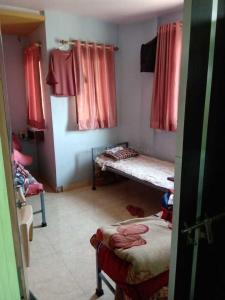 Bedroom Image of Laxmi Niwas PG in New Panvel East
