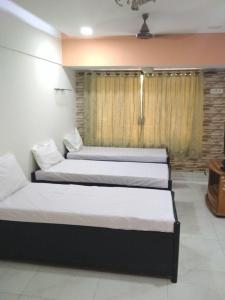 Bedroom Image of Lake Bloom Residency PG in Andheri East