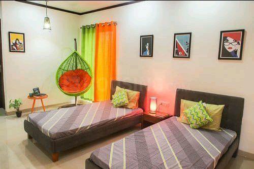 अंधेरी ईस्ट में मुंबई पीजी के बेडरूम की तस्वीर