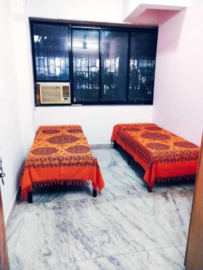 घनसोली में तत्व पेइंग गेस्ट के बेडरूम की तस्वीर