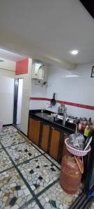Kitchen Image of No Restrictions And Full Freedom PG Rooms Available In Bandra West in Bandra West