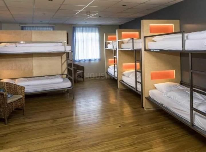 दम दम में कृष्ण होस्टल में बेडरूम की तस्वीर