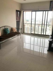 Gallery Cover Image of 550 Sq.ft 1 BHK Apartment for rent in Brijdham Nanddham Cooperative Housing Society, Goregaon West for 25000