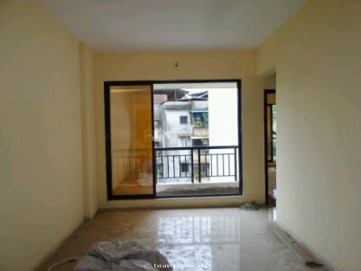 Gallery Cover Image of 700 Sq.ft 1 BHK Apartment for buy in Chinchodyacha Pada for 4200000