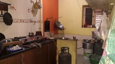 Kitchen Image of Laxmi Sri Nivas PG in Bommasandra