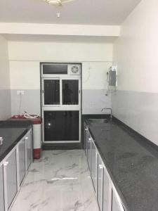 Kitchen Image of Sidhi Vinayak PG in Goregaon East