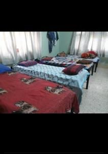 Bedroom Image of Singh PG Home in Govindpuri