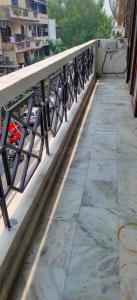 Balcony Image of Girls And Boys PG in Rajouri Garden