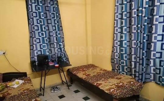 महावीर एनक्लेव में बॉइज़ पीजी के बेडरूम की तस्वीर