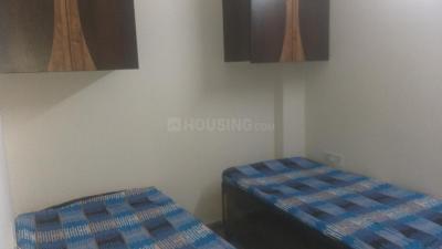 लक्ष्मी नगर में नारायणी बॉइज़ पीजी के बेडरूम की तस्वीर