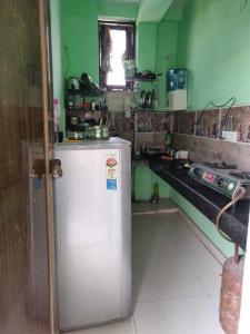 Kitchen Image of Abhinav Associates PG in Govindpuri