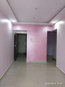 Gallery Cover Image of 710 Sq.ft 1 BHK Apartment for rent in Guru Mauli Niwas, Rabale for 14000