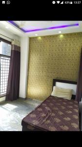 पटेल नगर में रेडी टू मूव पीजी के बेडरूम की तस्वीर