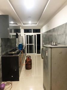 Kitchen Image of Shree Laxmi Accommodation in DLF Phase 5