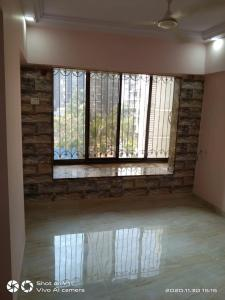 Gallery Cover Image of 630 Sq.ft 1 BHK Apartment for buy in Romell Empress, Borivali West for 8500000