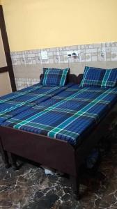 प्रशांत होमेज पीजी इन सेक्टर 66 के बेडरूम की तस्वीर