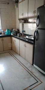 Kitchen Image of Astha PG Rooms in Kandivali East