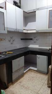 Kitchen Image of Radhe Krishna PG in Laxmi Nagar