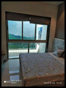 Gallery Cover Image of 645 Sq.ft 1 BHK Apartment for buy in Bachraj Lifespace, Virar West for 3410000