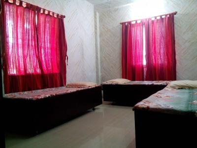 Bedroom Image of Unique Residency in Navrangpura