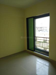 Gallery Cover Image of 895 Sq.ft 2 BHK Apartment for rent in Om Residency, Nevali for 8000