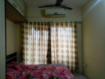 Gallery Cover Image of 750 Sq.ft 1 BHK Apartment for buy in Malad West for 8500000