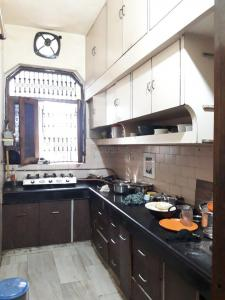 Kitchen Image of Nand Vatika PG in Sector 3 Rohini