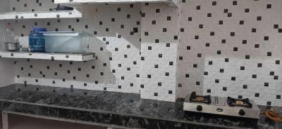 Kitchen Image of Komal PG in Rajouri Garden