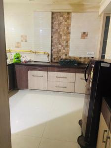 Kitchen Image of Ajay Paying Guest Accommodation in Vastrapur