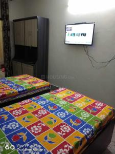 Bedroom Image of Welcome To Radhe PG in Lajpat Nagar