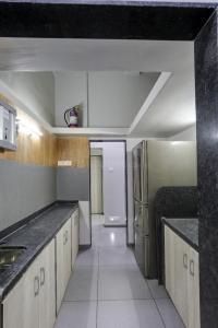 Kitchen Image of Yash Shelters PG in Sadashiv Peth