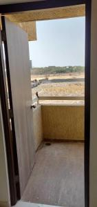 Gallery Cover Image of 996 Sq.ft 1 BHK Apartment for rent in Dhanori for 16000