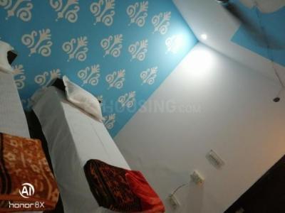 संजीव पीजी इन सेक्टर 14 के बेडरूम की तस्वीर