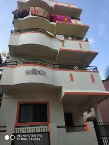 Building Image of Om Sai PG in Wagholi
