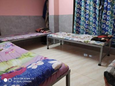 बेलापुर सीबीडी में राहुल होस्टल एंड पीजी में बेडरूम की तस्वीर