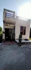 Gallery Cover Image of 1200 Sq.ft 2 BHK Independent House for buy in Dholai for 7000000