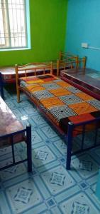 Bedroom Image of Chennai Sr Mens Hostel in Navalur